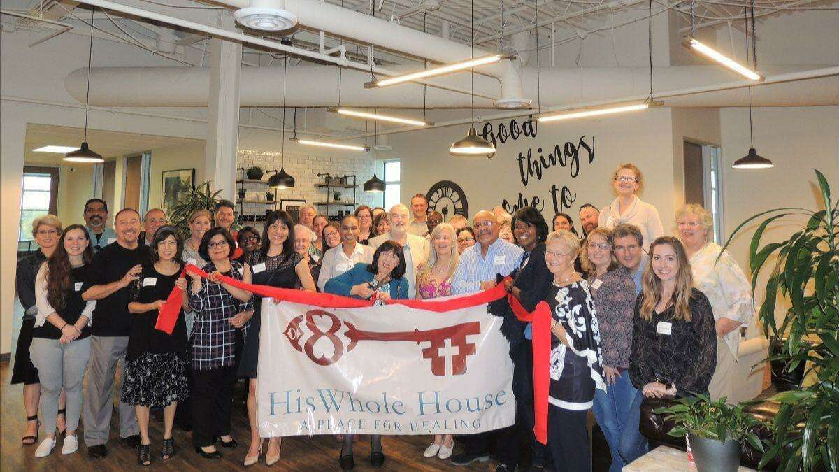 His Whole House team members pose for a photo during a ribbon cutting ceremony in this picture taken before the pandemic.