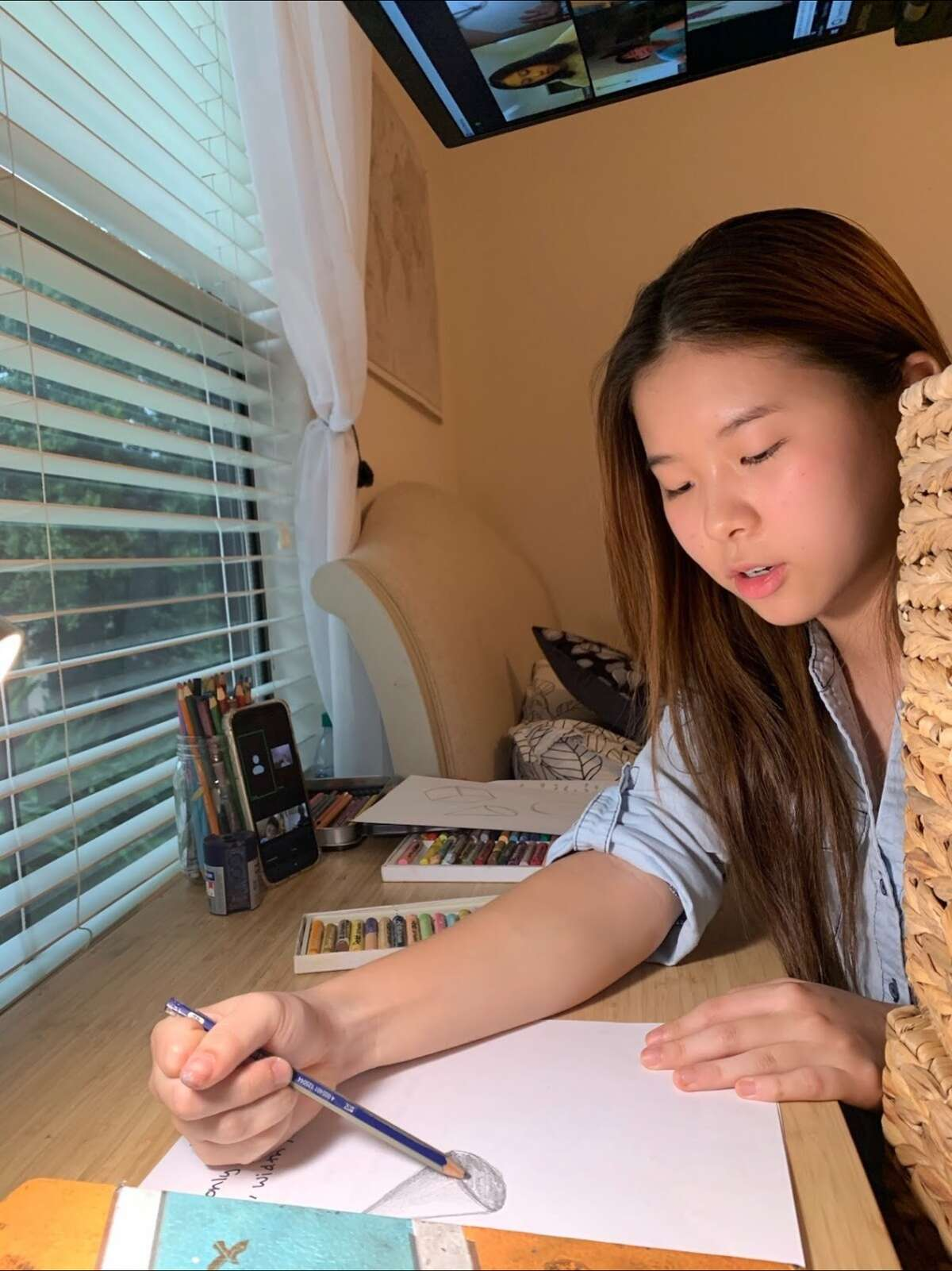 Teaching to Give officially opened on Sept. 9, providing tutoring lessons via Zoom for academic subjects, along with foreign language and the arts. Pictured: Lina Wu.