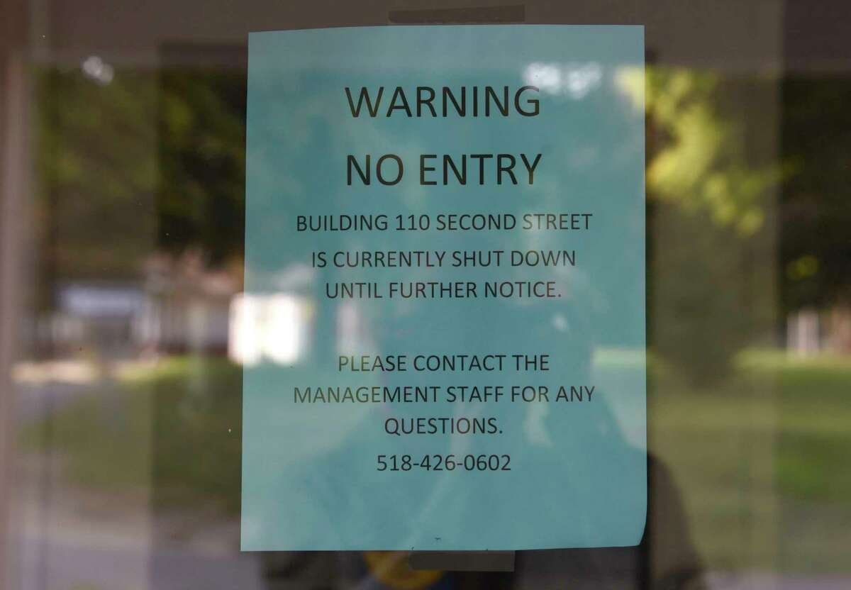 A no entry sign is posted on the front front door of the fire-damaged Idlewild Apartments on Friday, Sept. 18, 2020 in Albany, N.Y. (Lori Van Buren/Times Union)