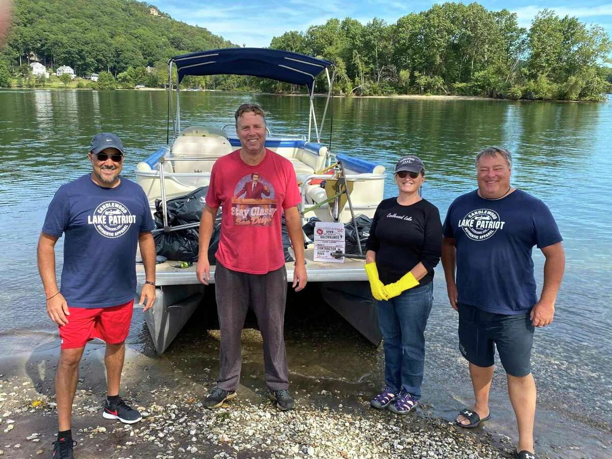 Volunteers spent four weekends cleaning up the islands around Candlewood Lake.