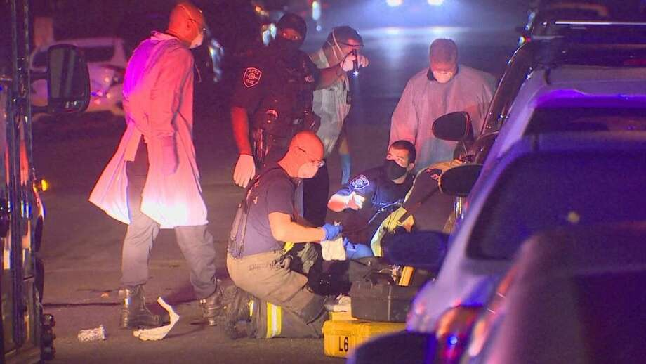 Police and medics respond to the scene of the stabbing. Photo: Courtesy Of KOMO News