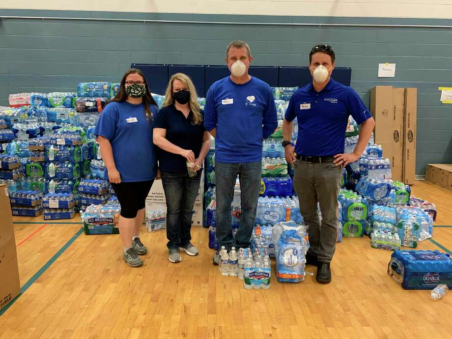 Alan Chichester volunteered alongside his Consumers Energy colleagues at Meridian Elementary School in filling orders and organizing flood relief supplies. (Photo provided)