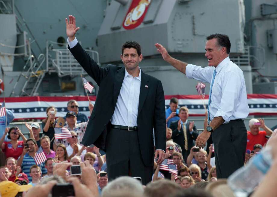 In August 2012, Republican presidential candidate Mitt Romney, right, and vice-presidential candidate and Wisconsin congressman Paul D. Ryan wave to supporters in Norfolk, Va. Photo: Washington Post Photo By Ricky Carioti. / The Washington Post