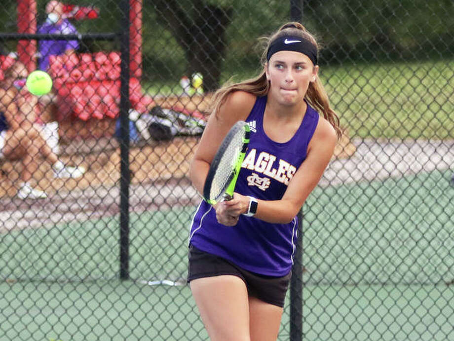 CM's Hannah Butkovich, shown hitting a backhand in Wednesday's dual with Jersey in Alton, was in Greenville for a girls tennis quad Thursday and went 3-0 in three Eagles victories. Photo: Greg Shashack / The Telegraph