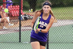 CM's Hannah Butkovich, shown hitting a backhand in Wednesday's dual with Jersey in Alton, was in Greenville for a girls tennis quad Thursday and went 3-0 in three Eagles victories.