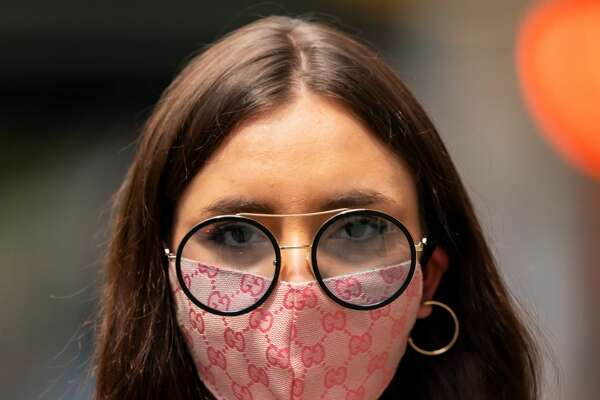 NEW YORK, NEW YORK - MAY 07: A woman is seen wearing a protective face mask during the coronavirus (COVID-19) pandemic in the Upper East Side on May 7, 2020 in New York City. (Photo by Gotham/Getty Images) A recent study suggests that wearing eyeglasses may actually lower your risk for catching COVID-19. According to a new study published in JAMA Opthamology, researchers discovered an interesting trend in China.  Scientists found that people in Wuhan, China who wore eyeglasses at least eight hours a day had a lower chance of contracting the virus.