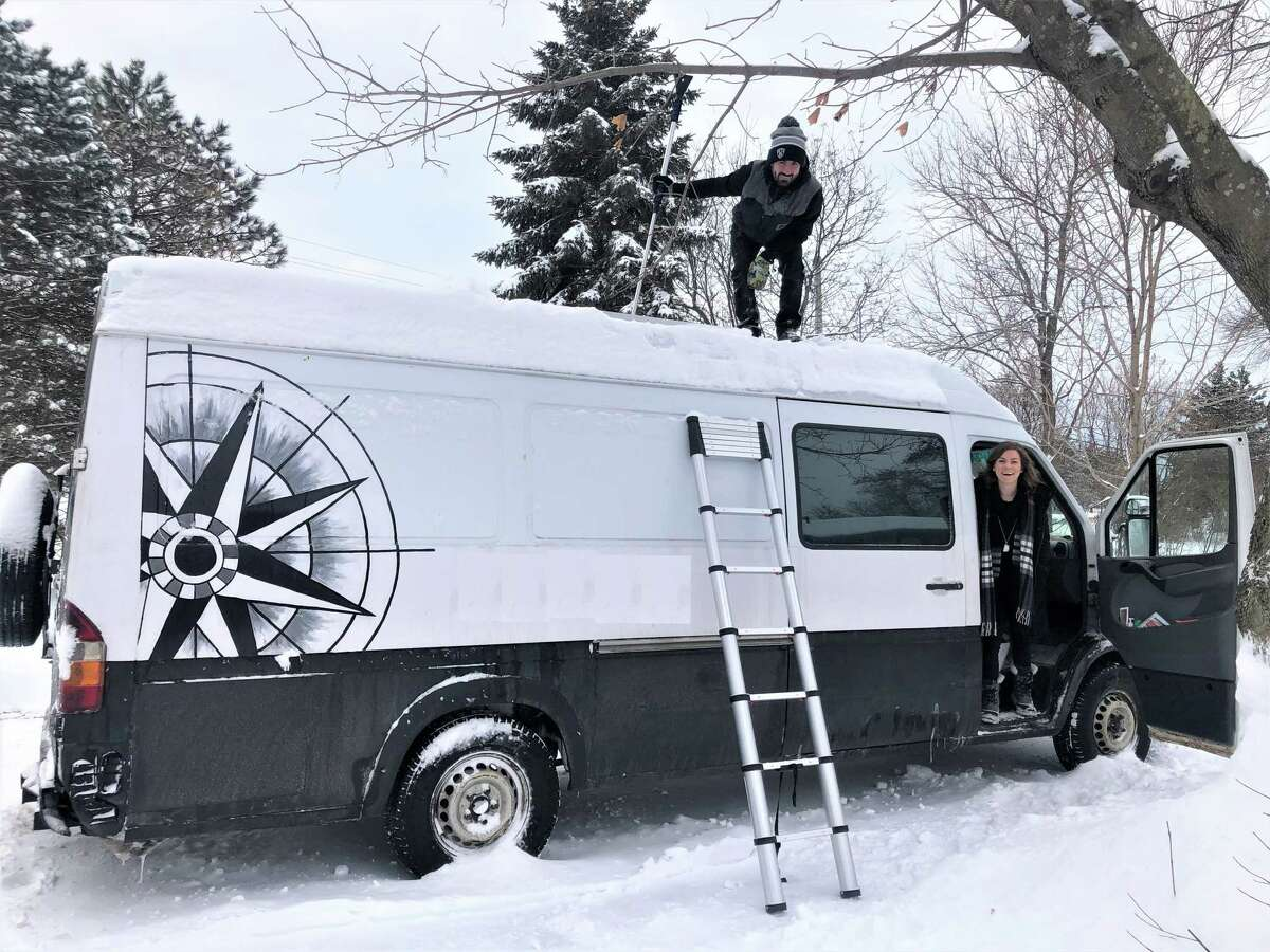Van life veterans Alexandra Napoli, left, and Frankie McCullough, seen here in Ontario in January, say finding a place to spend the night is more complicated in the winter.