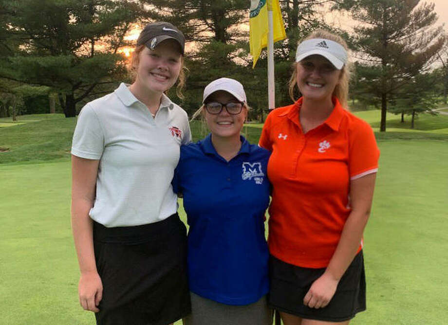 Triad's Emma Hill, left, Marquette's Audrey Cain, center, and Edwardsville's Riley Burns first played golf together nine years ago. On Wednesday, they played their first high school match together. Photo: For The Intelligencer