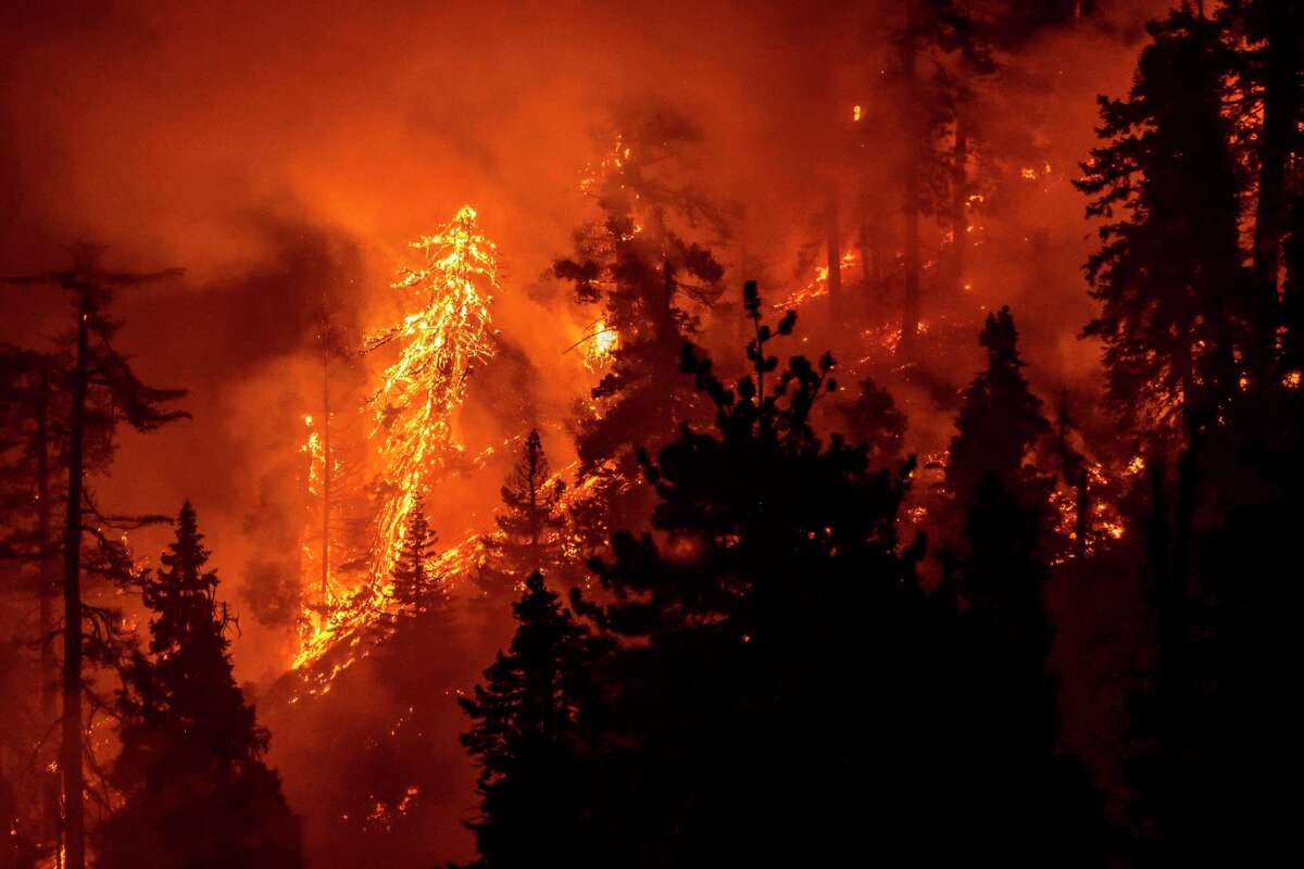 The Bobcat Fire continues to burn through the Angeles National Forest in California Sept. 17. More than two dozen major wildfires on the West Coast are sending smoke into the sky that can be seen across the country, including Connecticut.