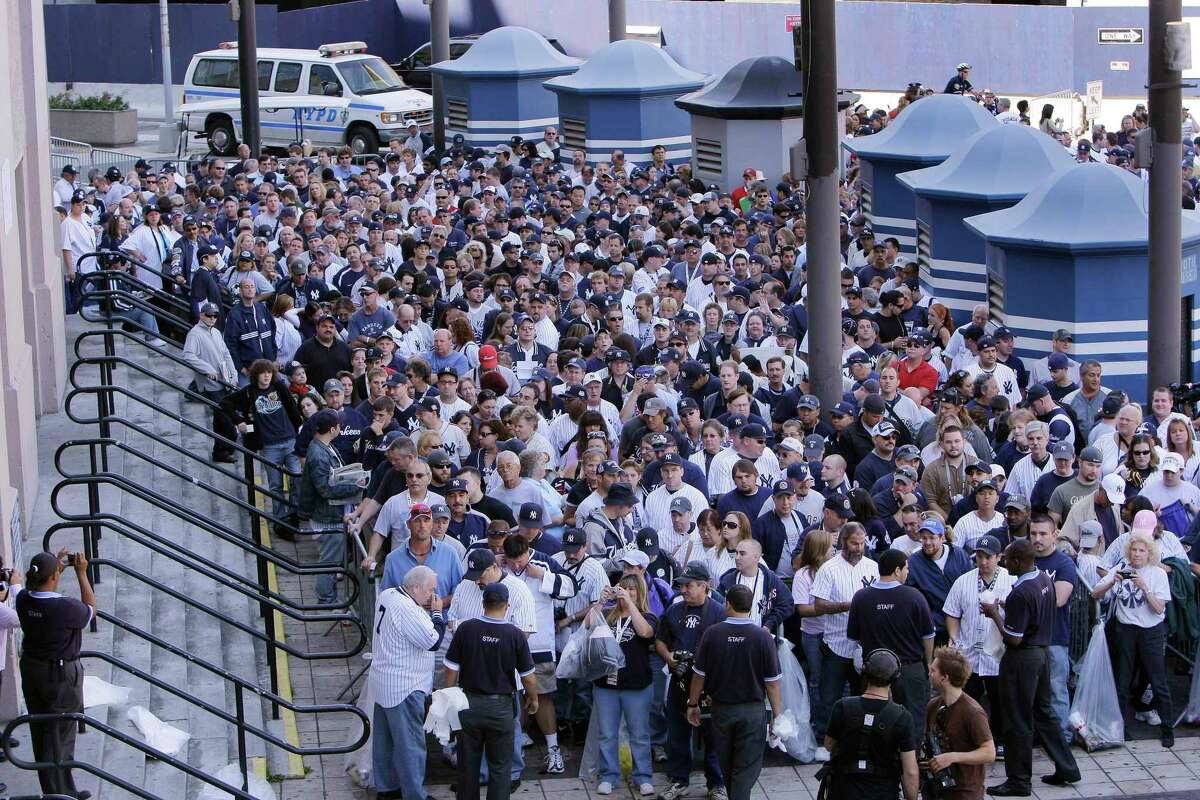 Fans crowd outside Yankee Stadium on Sunday, Sept. 21, 2008 in New York. There have been, for example, enough deaths from the coronavirus to fill every seat in MetLife Stadium (where the Giants and Jets play) a bit less than two-and-a-half times. For the baseball fans out there, you could fill Yankee Stadium to capacity more than three-and-a-half times. You could fill Madison Square Garden 10 times. If the average height of an American adult is 5 feet, 9 inches (or 69 inches) that's 918.2 people for every mile. That means, you could lay all the victims of the virus in a straight line from New York City to Philadelphia (95 miles), and back, and make it some of the way toward Boston. There are, if you're curious, more than five times as many victims of COVID-19 in this country as there are McDonald's locations worldwide - and six-point-five times the number of Starbucks.