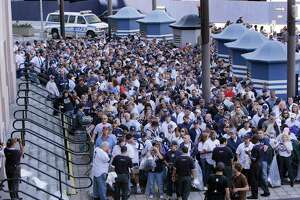 Fans crowd outside Gate 2 waiting to be let into Yankee Stadium to tour Monument Park and the field one last time, several hours before a baseball game between the New York Yankees and the Baltimore Orioles on Sunday, Sept. 21, 2008 in New York. Sunday was the Yankees' final regular season home game to be played at the stadium. (AP Photo/Julie Jacobson)