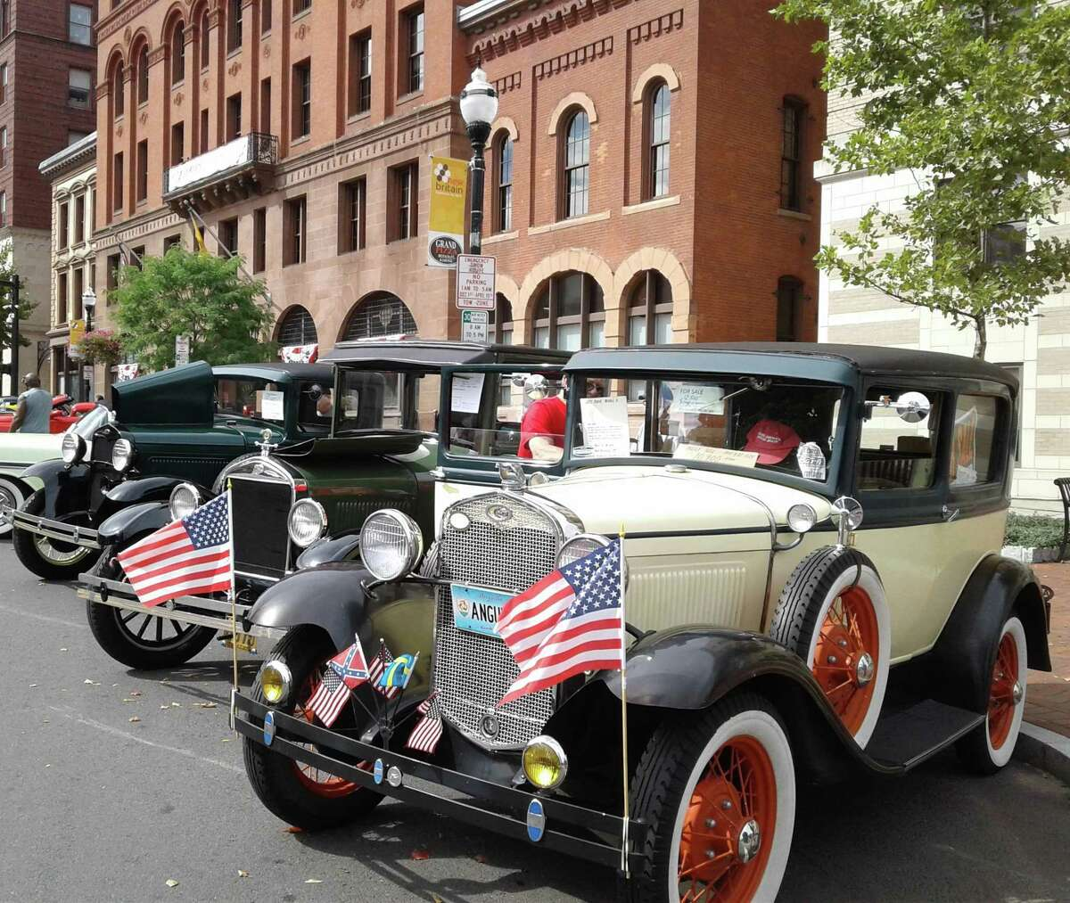 Cars are parked in front of town hall during the 2019 car show.