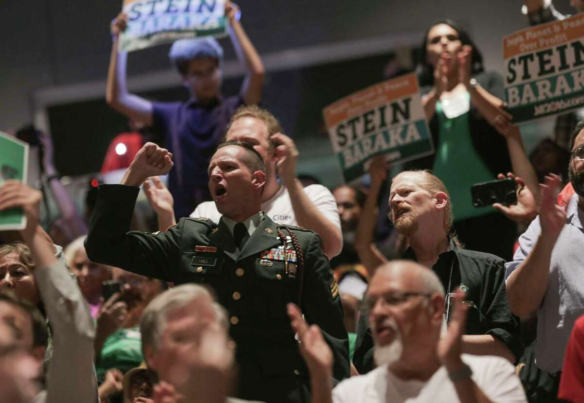 """Attendees of the Green Party's National Convention yell """"No more war"""" during the convention on Saturday, Aug. 6, 2016, in Houston. ( Elizabeth Conley / Houston Chronicle )"""