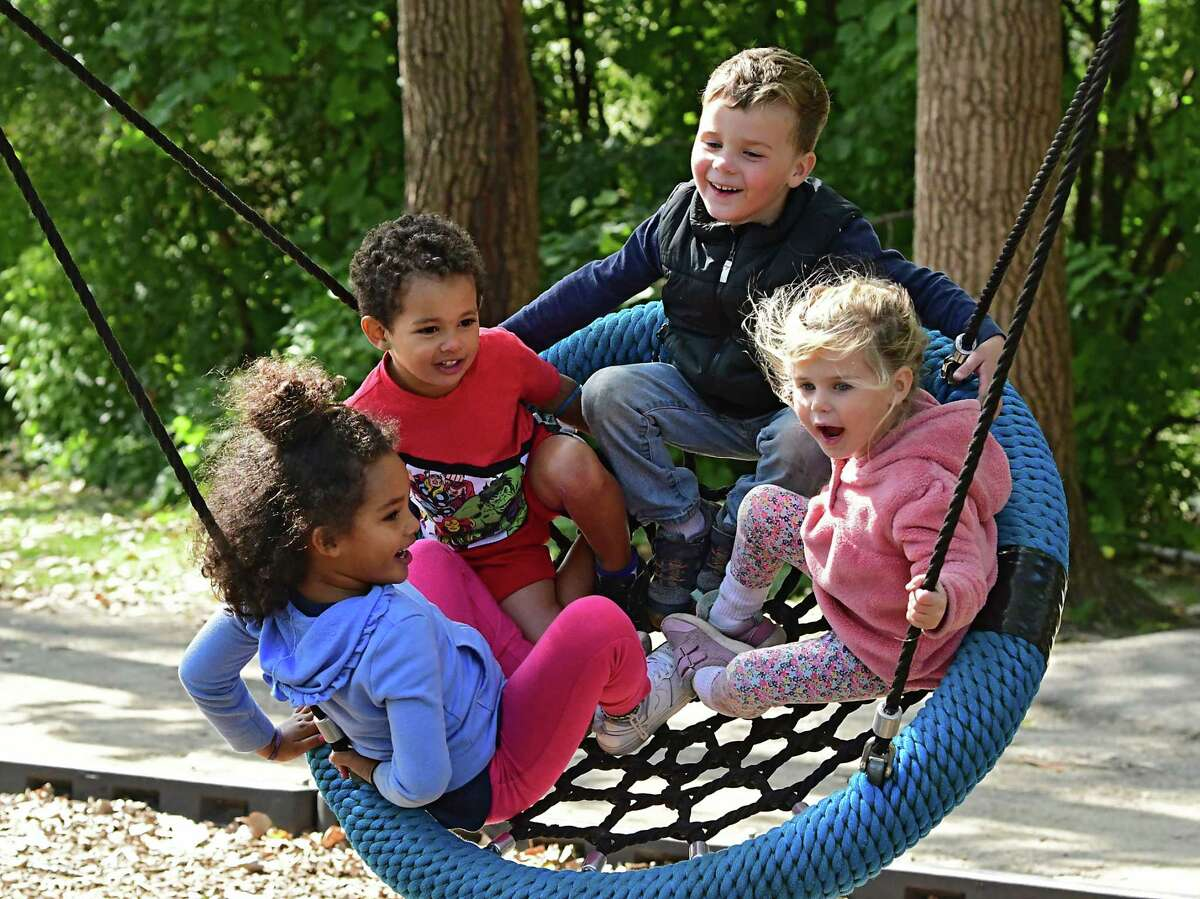 From left, sister and brother Kylie Vaughan, 5, and Levi, 3, of Albany join brother and sister Sebastian Daniels, 3, and Catherine, 2, of Albany on a swing at Buckingham Lake Park on Friday, Sept. 18, 2020 in Albany, N.Y. The children were chanting to their pusher
