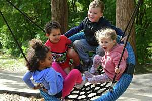 """From left, sister and brother Kylie Vaughan, 5, and Levi, 3, of Albany join brother and sister Sebastian Daniels, 3, and Catherine, 2, of Albany on a swing at Buckingham Lake Park on Friday, Sept. 18, 2020 in Albany, N.Y. The children were chanting to their pusher """"higher, faster!"""" (Lori Van Buren/Times Union)"""