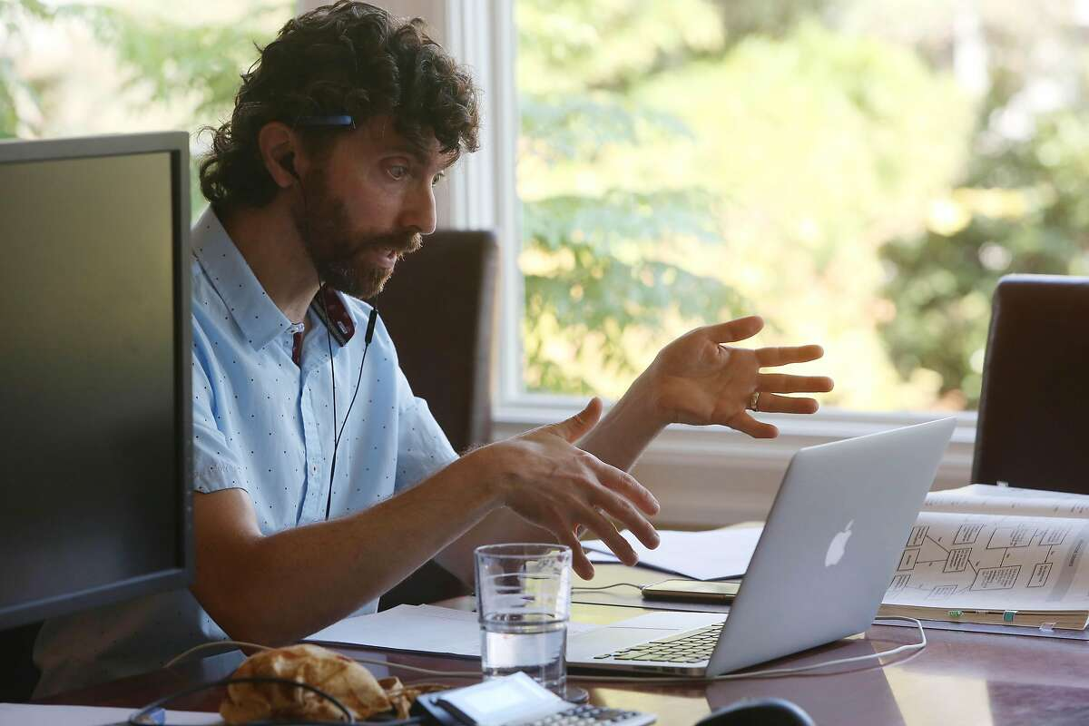 Daniel Schweitzer, state bar tutor, gestures with his hansds as he works on a lap top while talking to a client during a tutoring session from his home on Wednesday, September 16, 2020 in San Francisco, Calif.