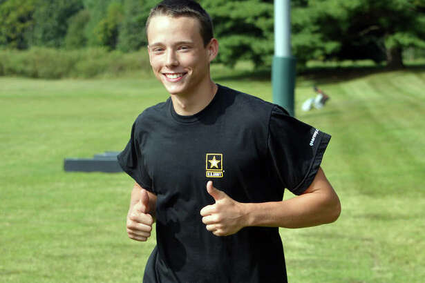 Metro-East Lutheran senior Jakob Schroeder practices with the MELHS cross country team.
