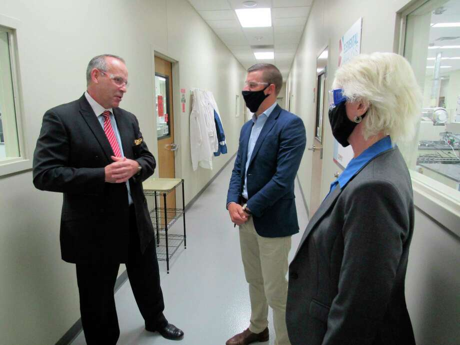 Impact Analytical CEO Neil Chapman, left, leads Lee Chatfield, speaker of the Michigan House of Representatives, and state representative Annette Glenn on a tour of Impact's laboratory facilities on Sept. 18, 2020. (Mitchell Kukulka/Mitchell.Kukulka@mdn.net).