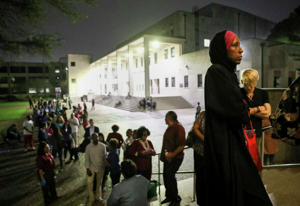 """""""I can remember when I did not have the right to vote,"""" said Nancy Glenn Griesinger, second from right, when asked why she waited so long in line to vote Tuesday, March 3, 2020, at Texas Southern University in Houston. After 10 p.m., a line of people still stretched out of the Robert James Terry Library as they waited to cast their votes."""