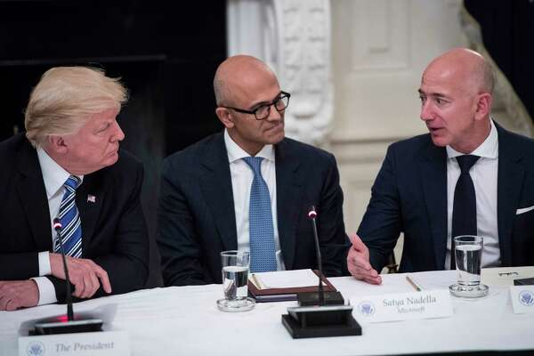 President Trump speaks with Microsoft chief executive Satya Nadella and Amazon chief executive Jeff Bezos in the State Dinning Room at the White House in 2017.