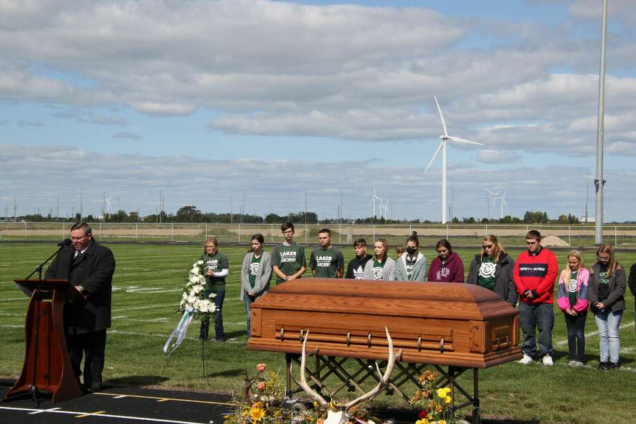 Hundreds were in attendance at the Laker School's football field for the funeral of Jeffery Powell. The ceremony included speeches from Pastor Ean Green, music from David Ross, and a 21-arrow salute from the Lakers archery team. Photo: Robert Creenan/Huron Daily Tribune