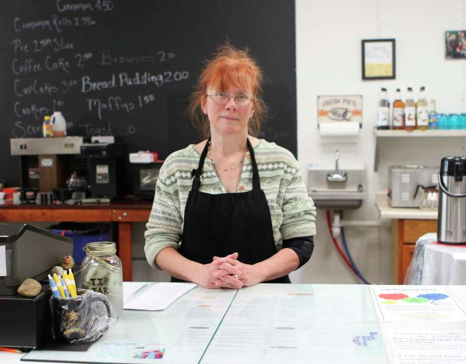 Paula Beilfuss, one of the owners of Three Girls Bakery in downtown Big Rapids, said she loves being able to bring a smile to her customer's faces every day. (Pioneer photo/Taylor Fussman)
