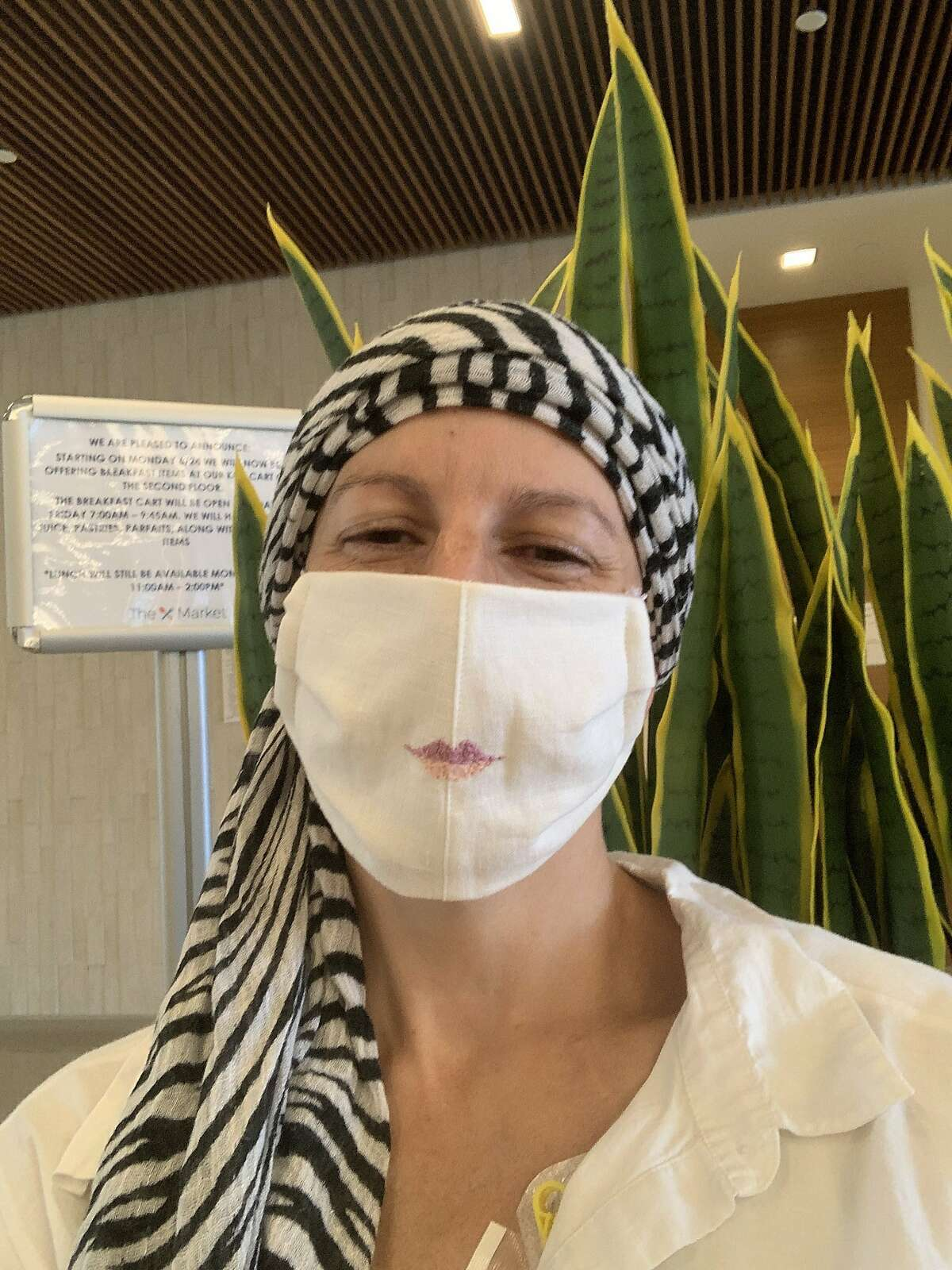 """""""My Chemo-Covid look...a mask to keep me safe, a headscarf to keep my bald head warm. This was taken in the lobby of my oncologists office at UCSD, waiting for my chemotherapy infusion appointment to start."""" Kimberly, San Diego, May 22, 2020"""
