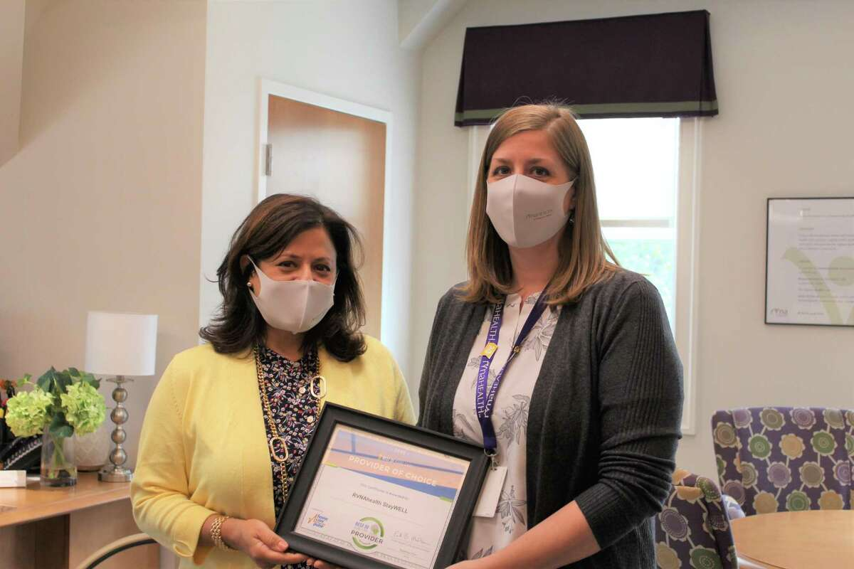 Theresa Santoro, RVNAhealth president & CEO and Melissa Woodhouse, director of RVNAhealth StayWELL Services, display the 'Provider of Choice' certificate. StayWELL Caregiving Services were introduced by RVNAhealth in 2014, part of Santoro's aim to build a 'continuum of care' that serves individuals across a lifetime.