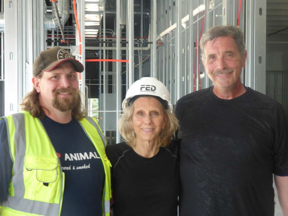 (From left) Dean, Bonnie and Greg Fischer have worked to reopen the Dublin General Store since the store burned down last year.