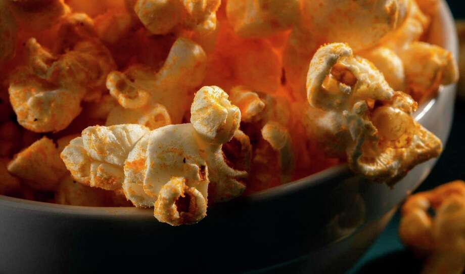 Sometimes, you just want popcorn for dinner. This recipe adds cheese flavor with powdered cheddar. (Zbigniew Bzdak/TNS) / Chicago Tribune