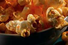 Sometimes, you just want popcorn for dinner. This recipe adds cheese flavor with powdered cheddar. (Zbigniew Bzdak/TNS)