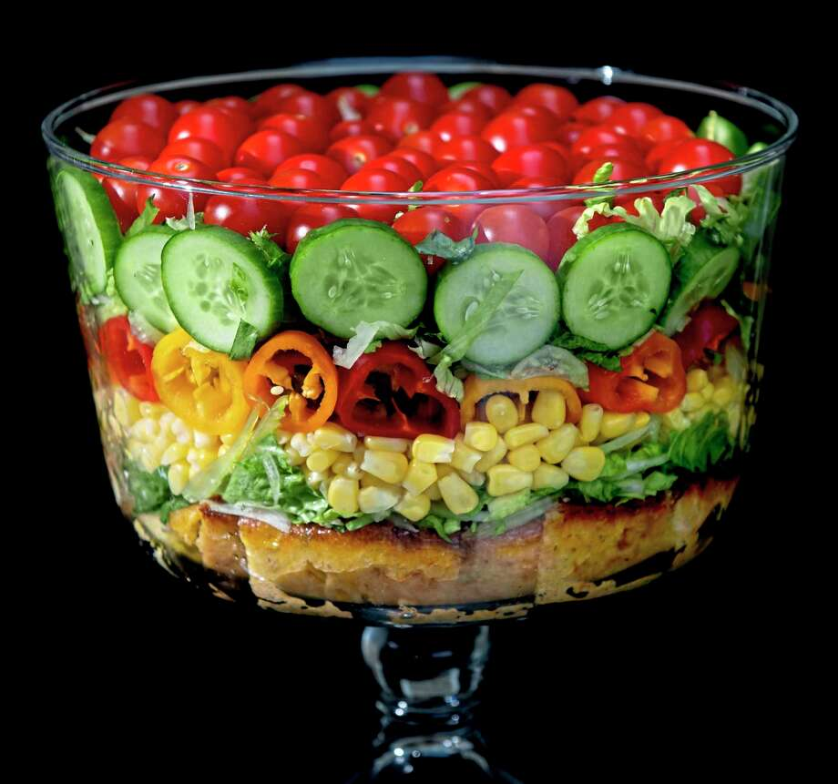 Built on a layer of savory cornbread, the summer trifle salad is made with shredded romaine lettuce, sweet corn, mini peppers, cucumbers and cherry tomatoes. Shot in Oakmont, Pennsylvania on Friday, Aug. 21, 2020. (Steve Mellon/TNS) / Pittsburgh Post-Gazette