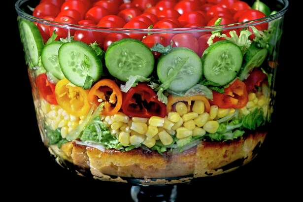 Built on a layer of savory cornbread, the summer trifle salad is made with shredded romaine lettuce, sweet corn, mini peppers, cucumbers and cherry tomatoes. Shot in Oakmont, Pennsylvania on Friday, Aug. 21, 2020. (Steve Mellon/TNS)