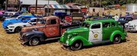 A classic car show stops off at the Peg House in Leggett, California.