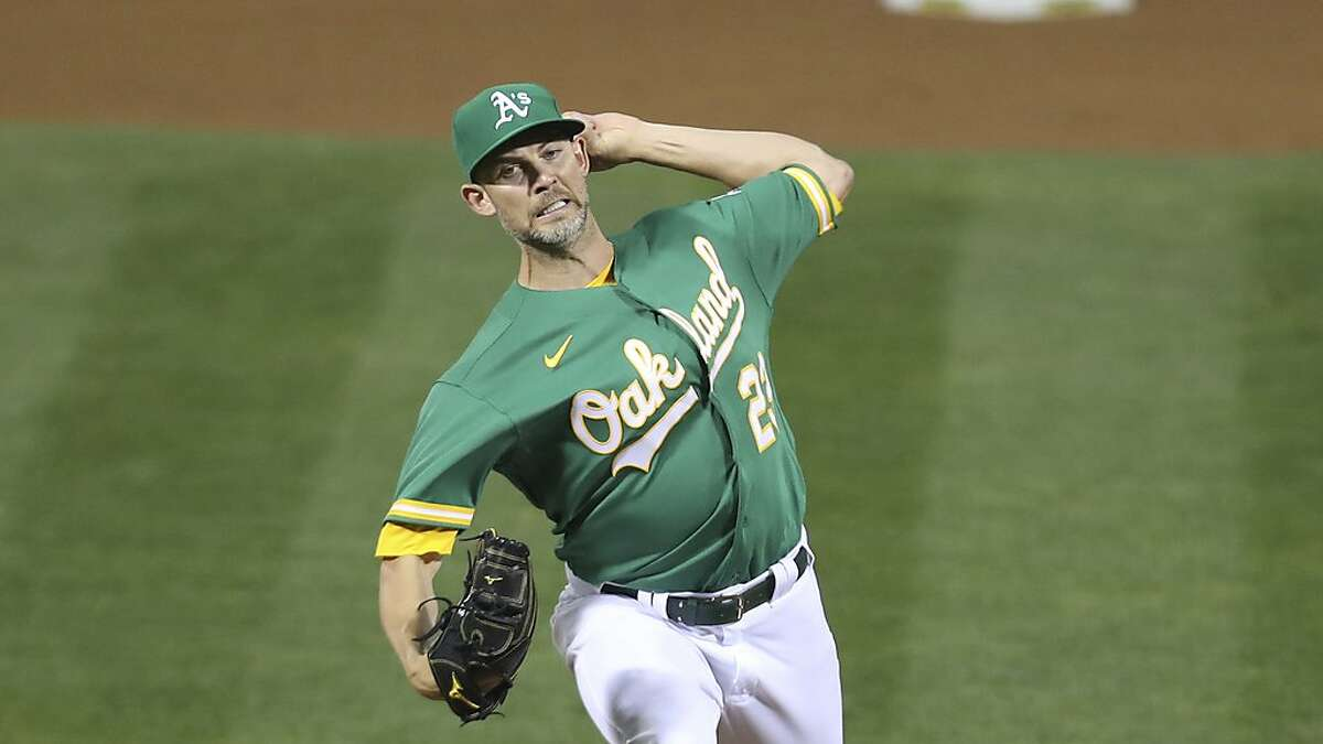 Oakland Athletics Mike Minor pitches against the Houston Astros during the second baseball game of a doubleheader in Oakland, Calif., Tuesday, Sept. 8, 2020. (AP Photo/Jed Jacobsohn)