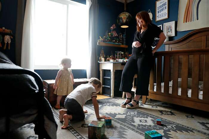Sam Brancato with her son, Max, 5, and daughter, Luna, 18 months, at their home in San Francisco, Calif., on Thursday, September 17, 2020. Brancato, who is pregnant, is concerned about the effect of wildfire smoke on her unborn child.