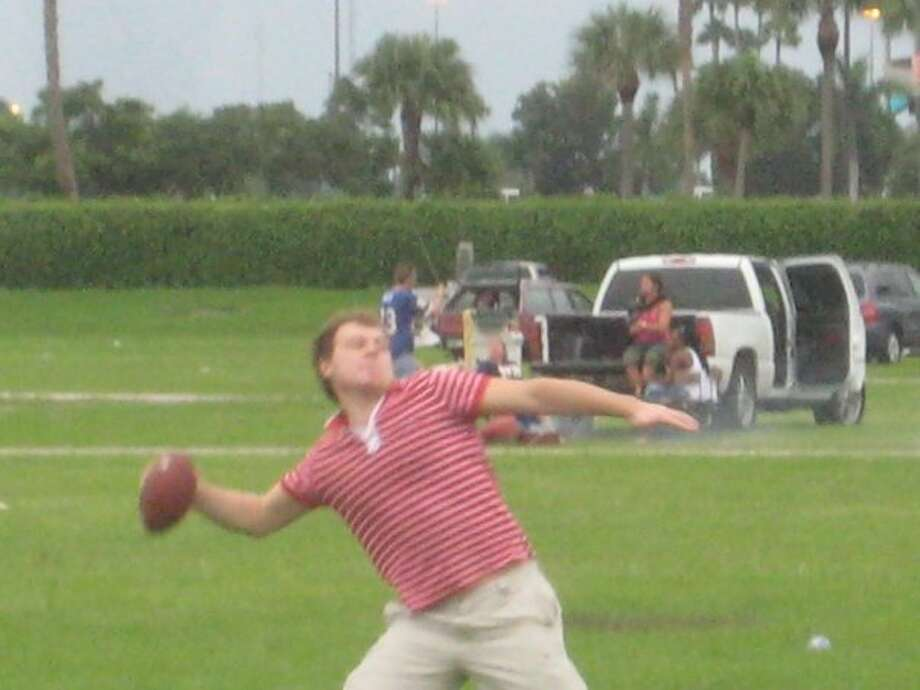 Anton Khudobin always has been a fun-loving sort. Here he's playing football before a Miami Dolphins game in 2008 when he was a member of the ECHL's Florida Everblades. Photo: Courtesy Malcolm Cameron