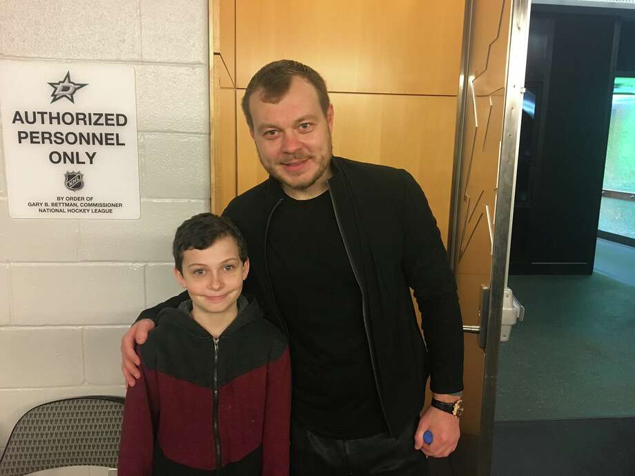Anton Khudobin and his former coach Malcolm Cameron's son Logan, then 11, before a Dallas Stars game in January 2019. Photo: Courtesy Malcolm Cameron