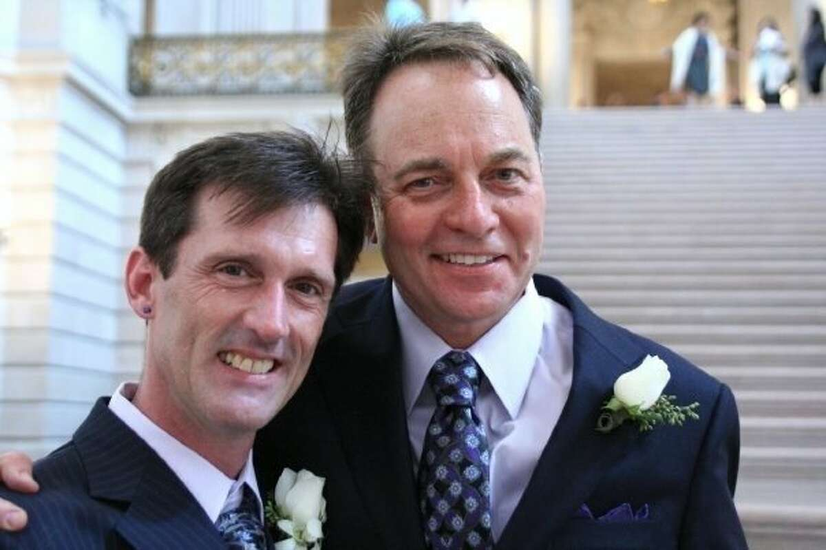 Brian and Kevin Fisher-Paulson pose for a photo on their wedding day on Sept. 19, 2008. In 2020, the couple celebrates 35 years since they first met.