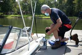 Nick McCord fills his boat with oil at the Palms Marina, Monday, Aug. 24, 2020, in Conroe.