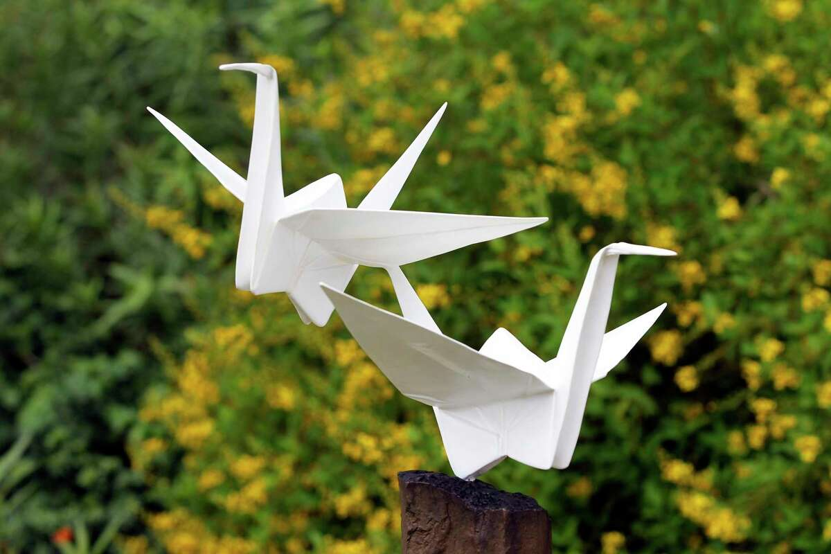 """""""Duo"""" is one of several depictions of cranes that can be found in an exhibit of origami-inspired art created by husband-and-wife team Kevin and Jennifer Box on display the San Antonio Botanical Garden."""