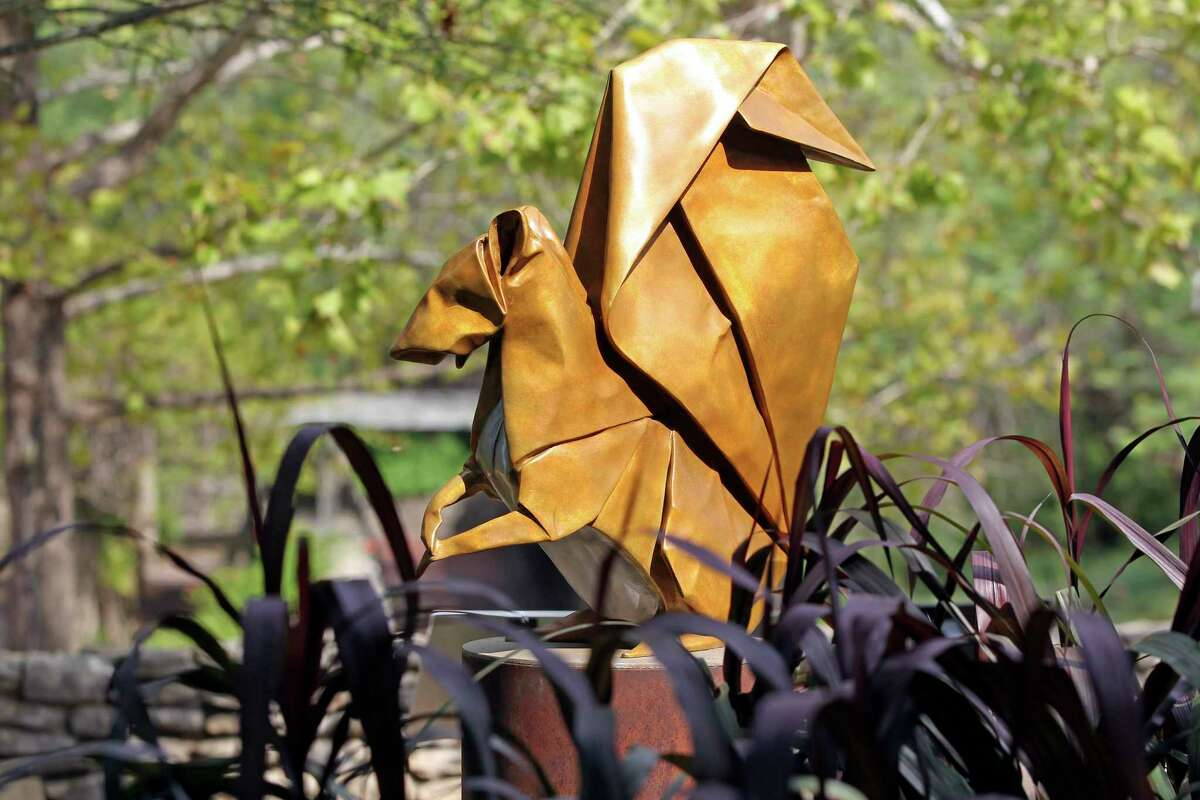 """""""Seed Sower"""" is part of an exhibit of origami-inspired art created by husband-and-wife team Kevin and Jennifer Box on display the San Antonio Botanical Garden."""