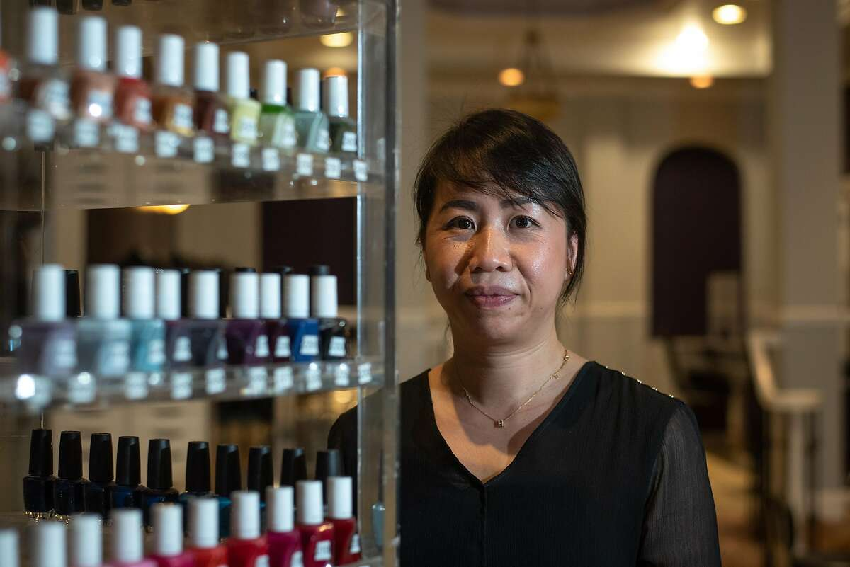Tracy Tran poses in her salon La Orquidea in Los Gatos on Sept. 17, 2020. The salon has just reopened up after months of closure due to the pandemic. Tran says she is happy to be open again, but worries how much longer they will be able to stay open if they do not attract more business.