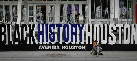 Marlon Watkins, 4, plays with his toy car inform of the Black History Houston Culture Fest sign on The Plaza at Avenida Houston Saturday, Feb. 15, 2020, in Houston.