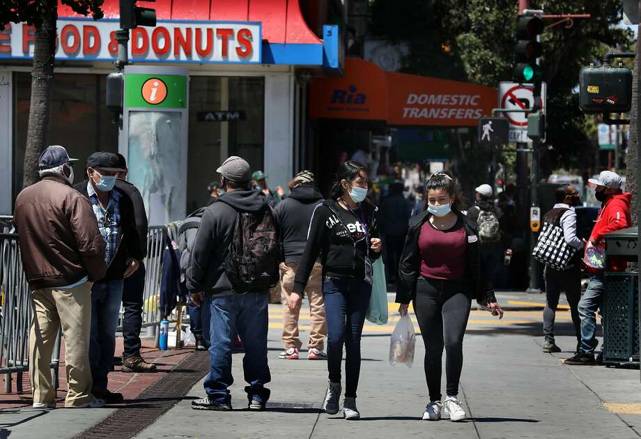 Pedestrians seen on Mission at 24th streets as businesses are re-opening in the Mission district on Tuesday, May 19, 2020, in San Francisco, Calif. Photo: Liz Hafalia / The Chronicle