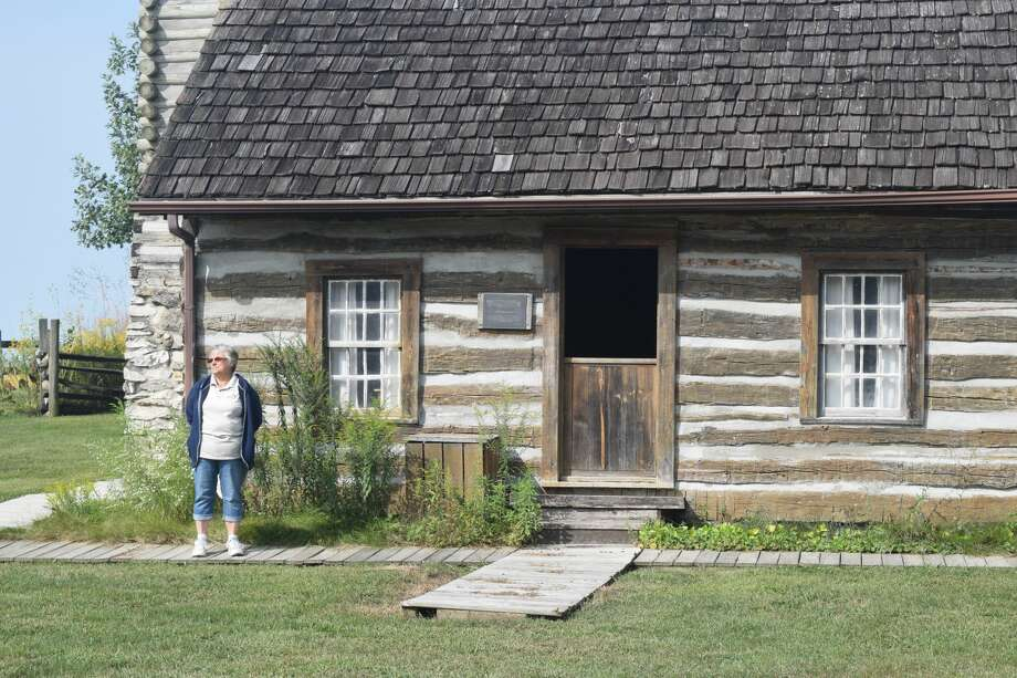 Debbie Krohe, a member of the Friends of the Rexroat Prairie, stands outside one of the cabins on the Rexroat Prairie grounds. The cabins have undergone renovation. Photo: Samantha McDaniel-Ogletree | Journal-Courier