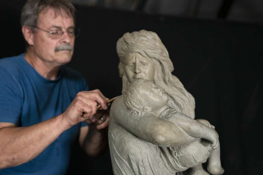 """Galveston artist Doug McLean's sculpture """"Hope"""" is slated to be unveiled in Galveston's new city park in mid-December. The haunting image originally comes from of a plaster study called """"Victims of Galveston Flood"""" created in 1904 by Pompeo Coppini, an Italian born sculptor. Photo: Doug McLean"""