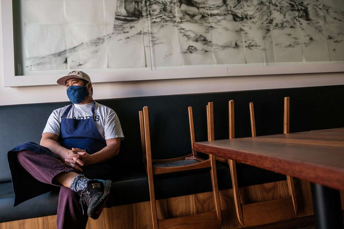 Brandon Jew pauses inside his Mister Jiu's restaurant prior to an all-staff meeting Sept. 18. He was nominated for a James Beard Award before it was decided not to hand them out this year.