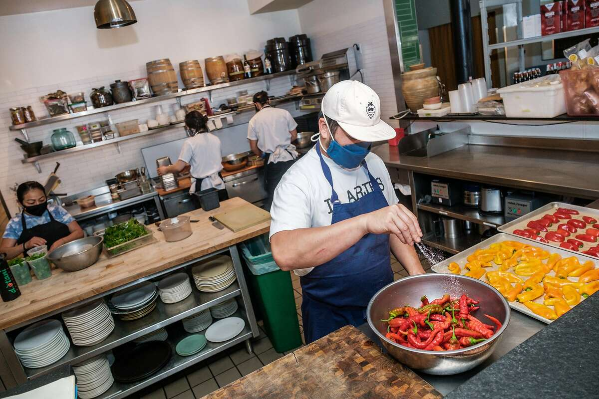 Owner of Mister Jiu's Restaurant Brandon Jew prepares food in his restaurant in San Francisco on Friday, September 18, 2020. Mayor London Breed announced that San Francisco restaurants may once again welcome diners inside as soon as the end of the month.