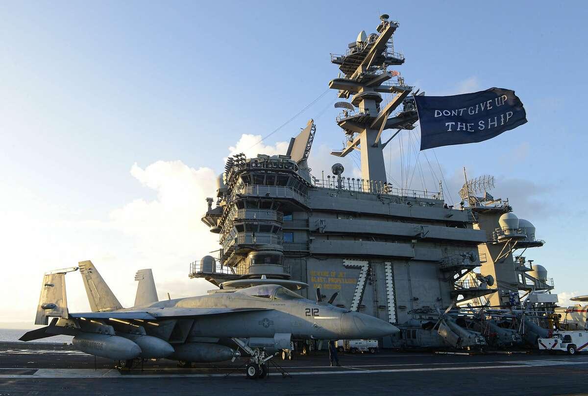 The aircraft carrier USS Theodore Roosevelt (CVN 71) flies a replica of Capt. Oliver Hazard Perry's